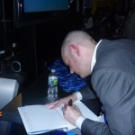 Brian David Johnson signs a copy of his book Screen Future at the Intel booth